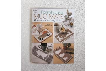 Farmhouse Mug Mats crochet pattern book.  Diy for 12 designs including honeybee, farm animals, truck, trees, cats, and dragonfly