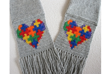 Autism awareness scarf.  Gray knit with crocheted puzzle piece hearts