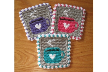 Colorful coffee cup coasters. Crochet mug rugs in pinks, blue, yellow and more