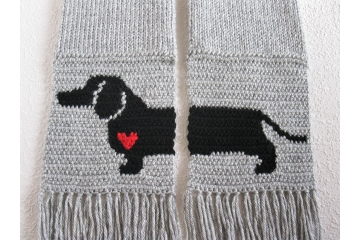 Gray knit scarf with a black Dachshund dog silhouette and small red heart