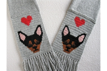 Chihuahua dog scarf. Gray knitted scarf with red hearts and black and tan dogs