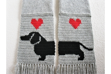Gray knit scarf with a black Dachshund dog silhouette and red hearts