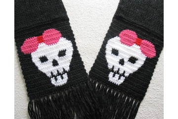 Black knit scarf with white skulls wearing pink bows