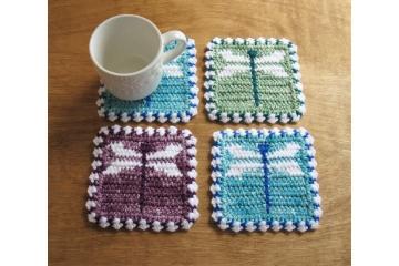 Dragonfly Coasters. Jewel tone mug mats with crochet dragon flies in blue, green or purple
