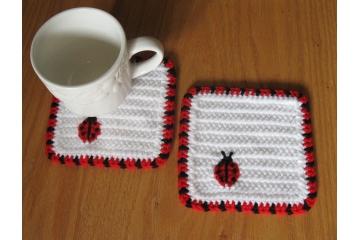 Ladybug Coasters. Large, white mug rugs with red and black Lady Bugs
