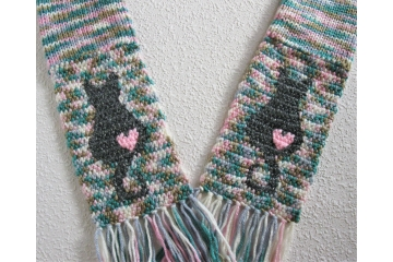 Kitty cat scarf. Colorful knit scarf with gray cat silhouettes and small pink hearts