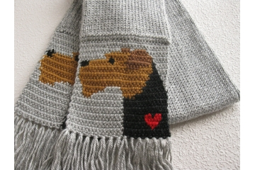 Airedale Terrier Scarf. Gray knit scarf with Welsh terriers and small red hearts.