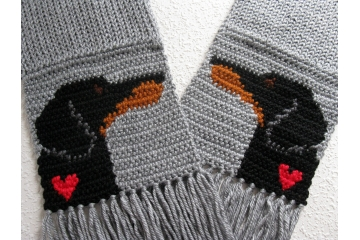 Dachshund Scarf. Gray knitted and crocheted scarf with black and tan weenie dogs and small hearts.