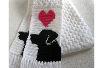 Labrador Retriever Scarf. White knit scarf with pink hearts and black lab dogs.