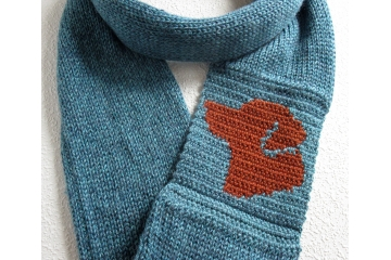 Labrador Infinity Scarf. Glacier blue knitted circle cowl with a fox red lab dog