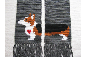 Corgi Dog Scarf. Charcoal gray crochet scarf with a tricolor Welsh corgi dog and small red heart.