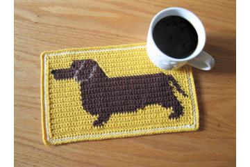 Dachshund dog crochet pattern. Yellow mug mat with a brown weenie dog